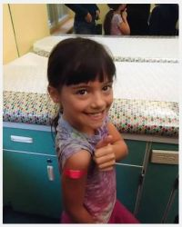 Sawyer shows off her band-aid after receiving her annual flu vaccination. Flu vaccines are recommended each year because the virus continually changes.