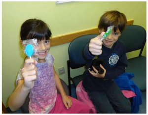 Aimee's children, Sawyer and Jack, proudly display their lollipops after receiving their annual flu vaccinations.